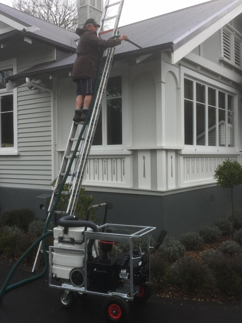 Photo of gutter cleaning service provided by Ewash.