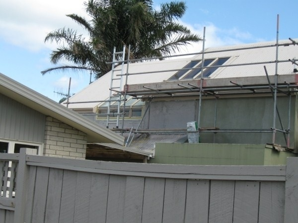 Photo of paint scaffolding set up on a house ready for the pre-paint washing service provided by Ewash.