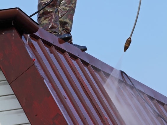 Photo of a roof being waterblasted as part of the roof cleaning service provided by Ewash.